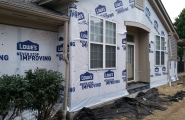 Tyvek house wrap and window trim-corners